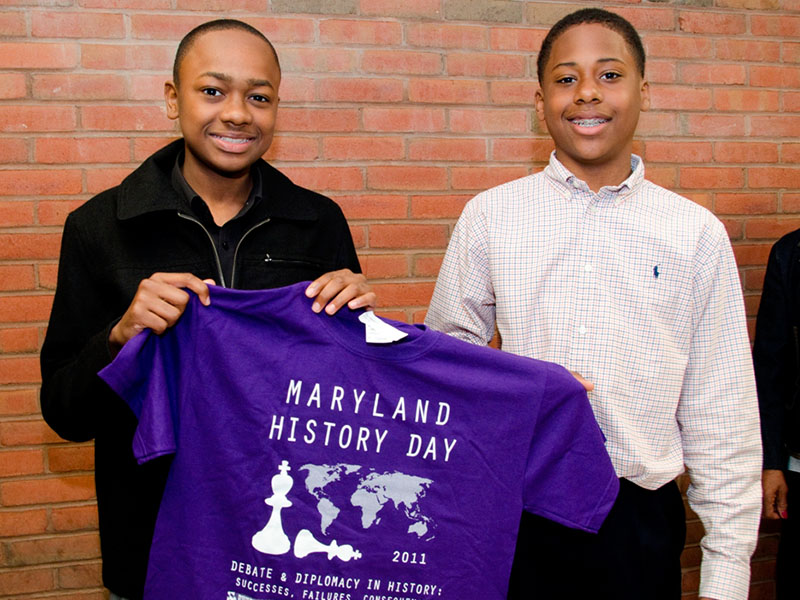 Maryland History Day Boys Holding Shirt