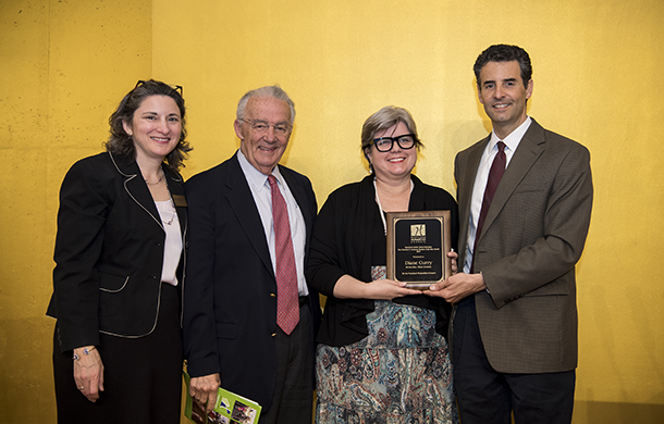 2016 Sarbanes Award recipient Diane Curry poses with Phoebe Stein, Senator Paul Sarbanes, and Congressman John Sarbanes.