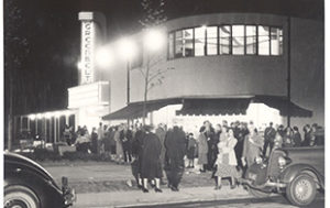 A vintage photograph of patrons outside the Old Greenbelt Theatre