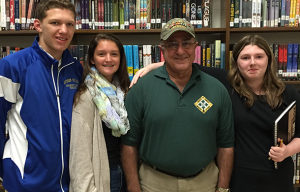 Veteran with Students at Library