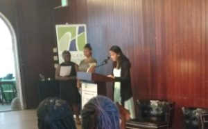 Three students Anastasia Farley, Maia Washington, and Cin'Shea Williams from the Writers in Baltimore Schools program providing remarks at the One Maryland One Book author reception.