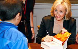 Author J.K. Rowling signs her book Harry Potter and the Deathly Hallows.