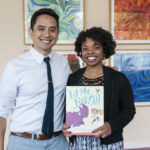 "Minh Lê (Keynote Speaker, Author) standing with Maryland Humanities board member Allyson Black. Ms. Black is holding a copy of ""Let Me Finish."""