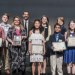 L-R Orlandra Foote (Level 2 State Runner-up), Max McKenna (Level 3 State Winner), Tara A. Elliot (2018 Christine D. Sarbanes Teacher of the Year Award recipient), Michael Sarbanes, Parker O'Brien (Level 2 State Winner), Dr. Phoebe Stein (Executive Director, Maryland Humanities), Gautam Anand Tangirala (Level 1 State Runner-up), Becky Brasington Clark (Director of Publishing, Library of Congress), Lucy Virgilio (Level 1 State Winner), Minh Lê (Keynote Speaker, Author)