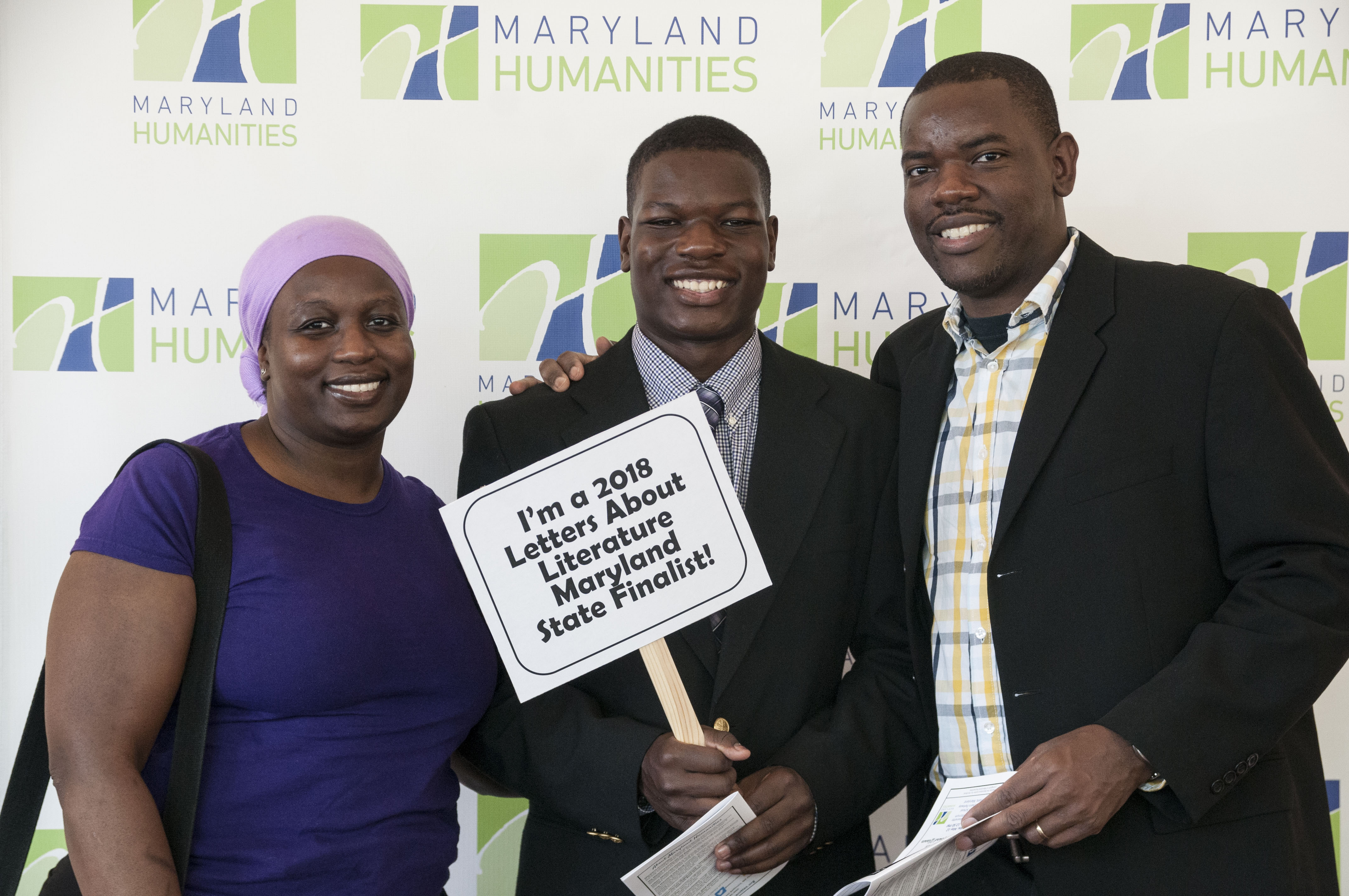2018 LAL finalist posing with family with congratulatory sign
