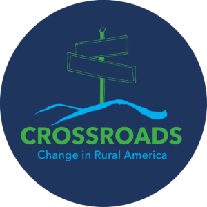 Image of dark blue circle and sign post graphic, with words in green and light blue, Crossroads, Change in Rural America.