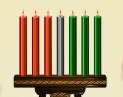 A Kwanzaa kinara (candle holder) with three red candles, one black candle, and three green candles, representing the seven principles of the holiday.